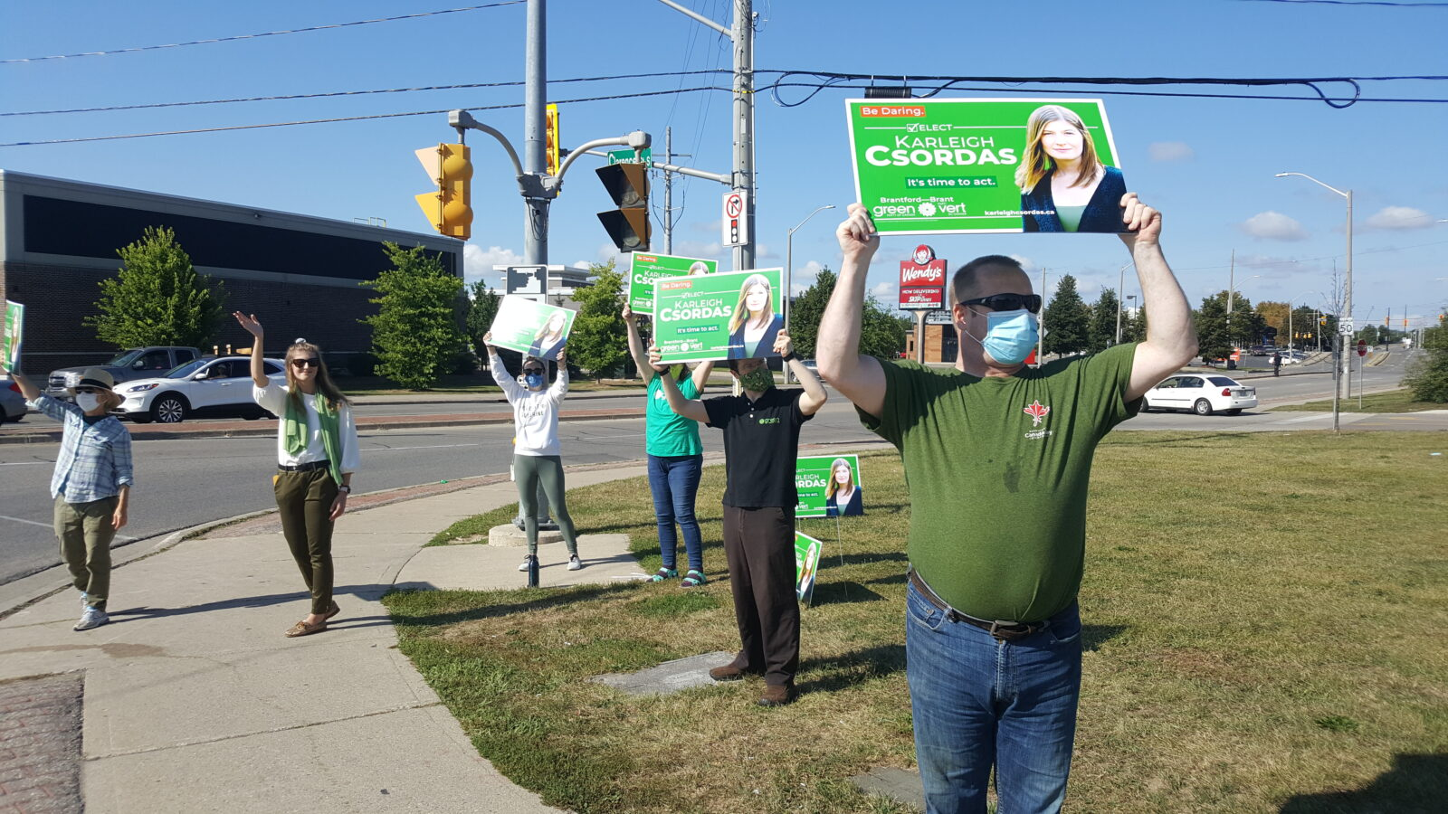 The campaign team waves signs