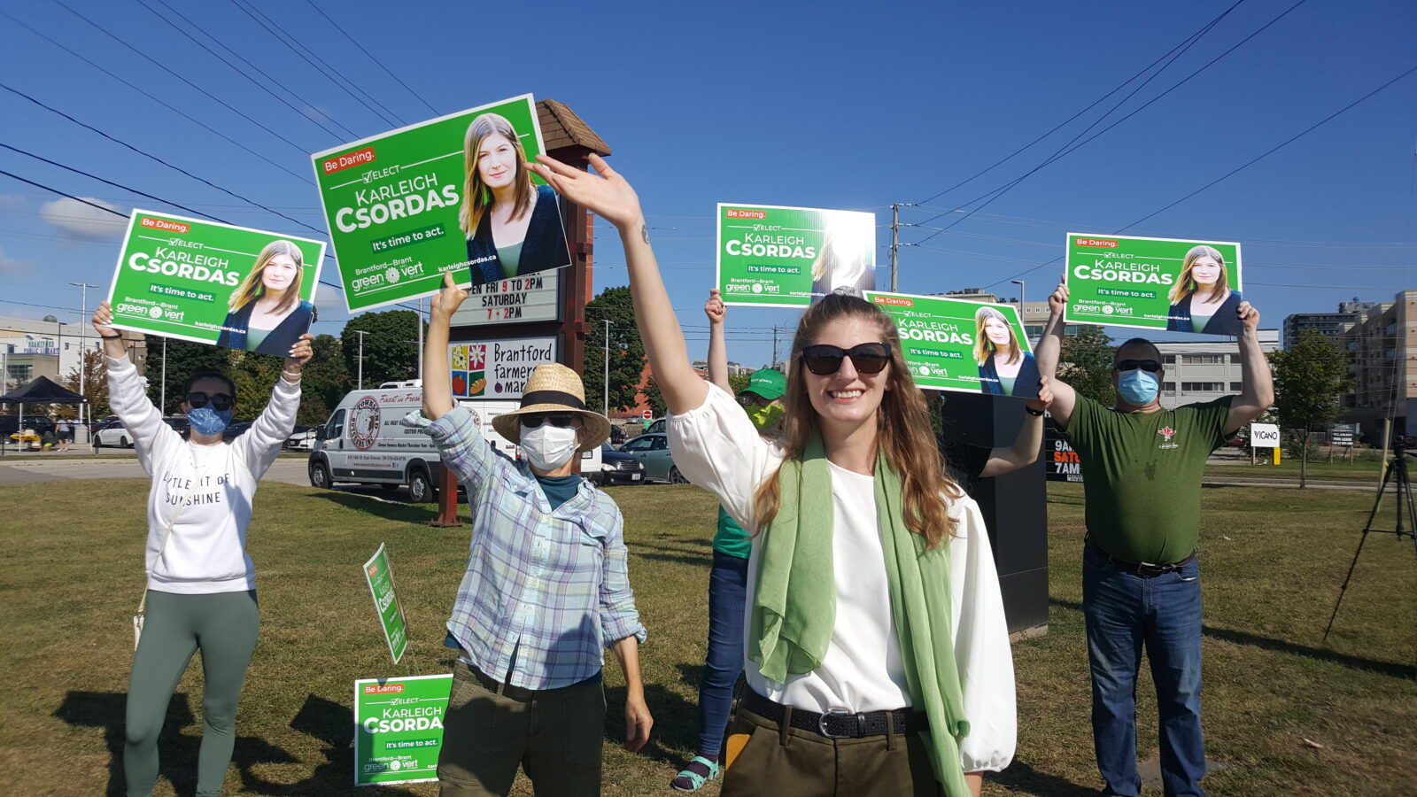 Karleigh Csordas with the campaign team waving signs