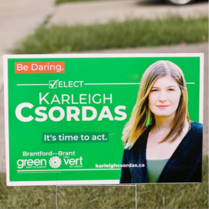 Lawn sign for Karleigh Csordas (Be Daring | Elect Karleigh Csordas | It's time to act | Brantford-Brant Green Party of Canada)